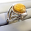 Silver weave ring in ring tray with opaque gold jewelpop inserted