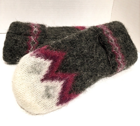 Back of hand view of gray wool mitts with ivory & pink zigzag pattern at tips