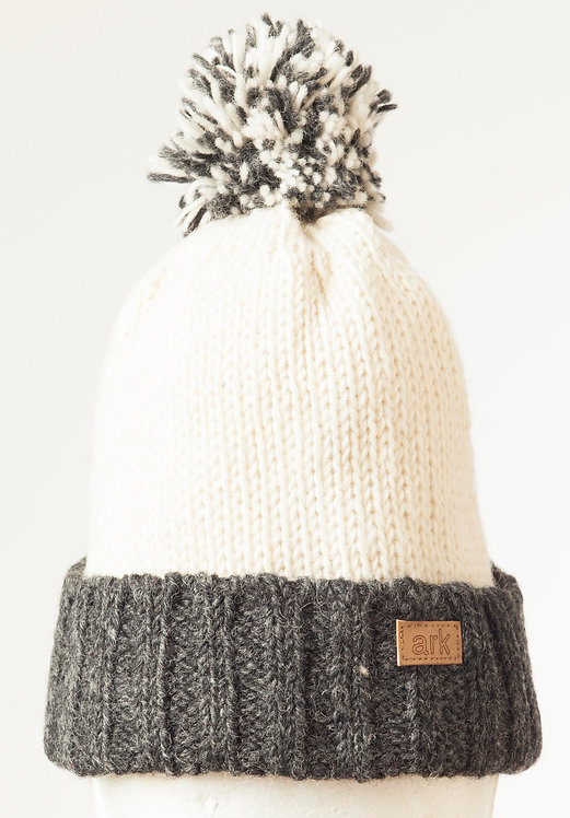 Natural white wool knit hat with ribbed charcoal cuff & pompom
