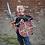 smiling boy dressed in ninja tunic holding Ninja EVA Foam Sword and matching shield