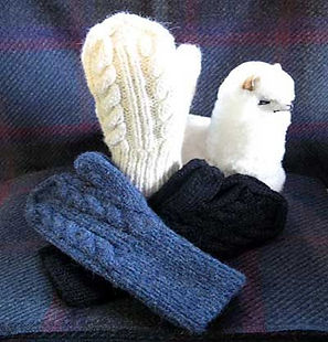 white, blue and black wool mitts with wool alpaca toy