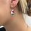 Woman wearing silver earring with European glass bead and anodized coloured aluminum disks