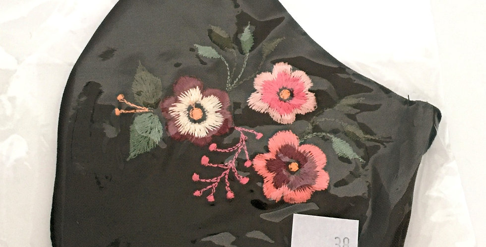 Side view of folded dark brown cotton mask - embroidery of fanciful posy of pink, coral & burgundy flowers with green leaves