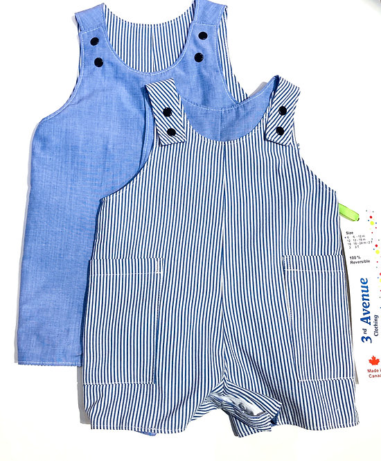 Two handmade reversible baby sized overall shorts, one solid blue, the other pink pinstripes
