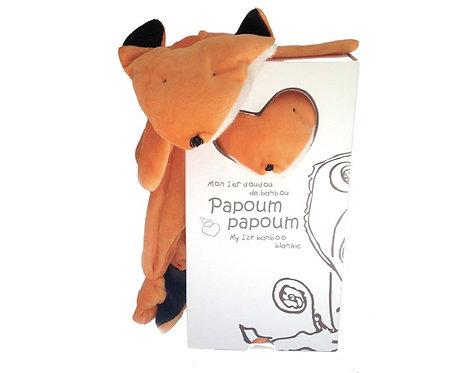 Orange rudimentary stuffed Bamboo Fox Blankie peeking out of box