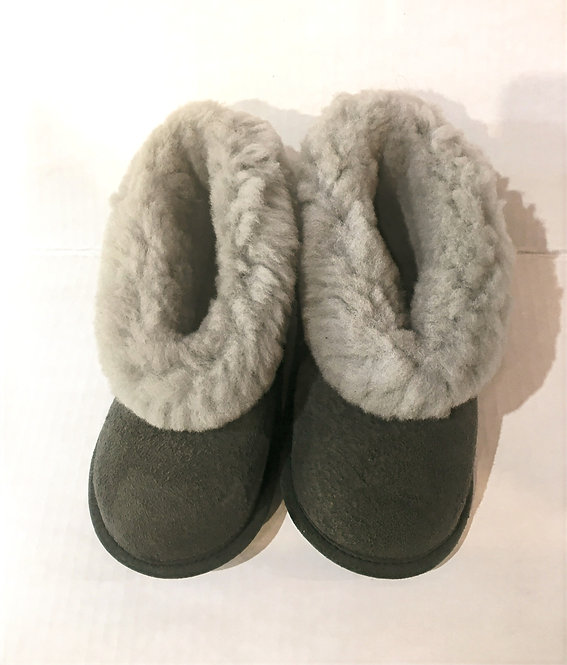 Top view of pair of kids gray sheepskin slippers with fluffy white cuffs