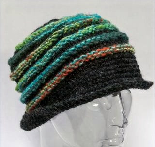 Charcoal chunky-knit wool hat with raised ridges of teal, lime & rust, curled brim turns up in back