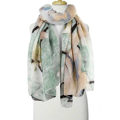 Long lightweight printed scarf in pastel shades of aqua & pink on a mannequin