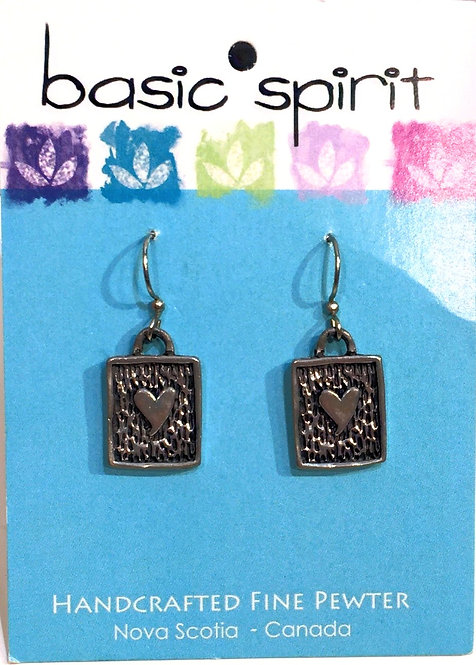 A pair of small rectangular pewter earrings with a heart in the center on a blue Basic Spirit card