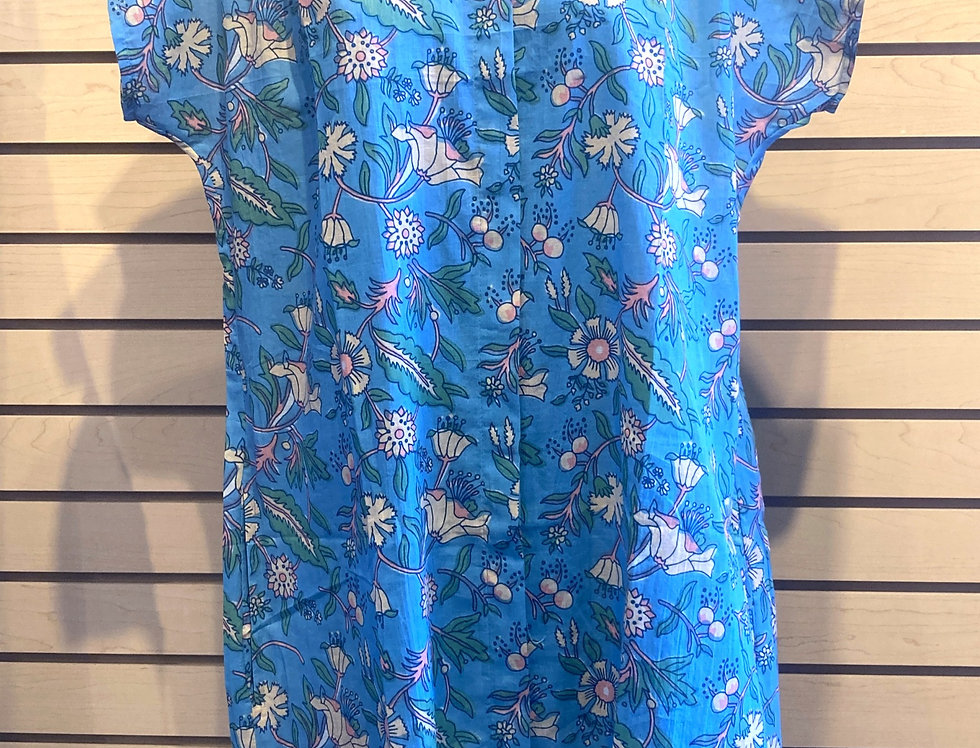 Front view of short-sleeve button up tunic on mannequin in blue & pink floral print