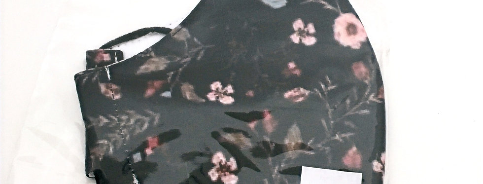 Side view of folded black mask withlight pink, moss &coral floral print