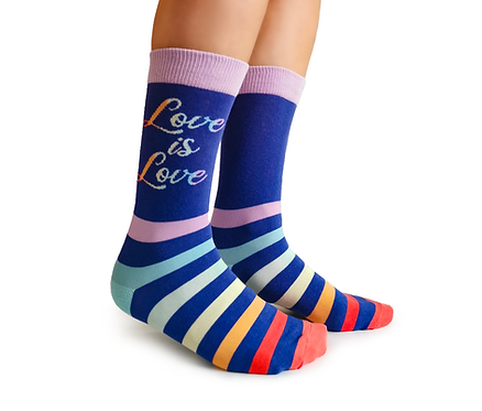 Side view of feet in blue socks with horizontal rainbow stripes - text 'Love is Love'