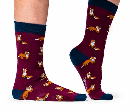 Right view of feet wearing burgundy & navy socks with orange & white foxes