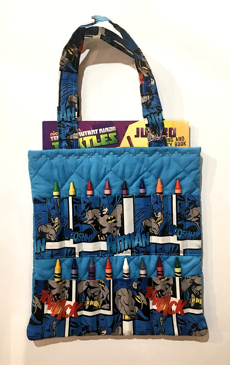 Flat rectangular blue cotton tote bag holding a crayon book & 16 slots for crayons on the front
