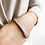 Double strand nude leather bracelet with rose-gold metal tube on model