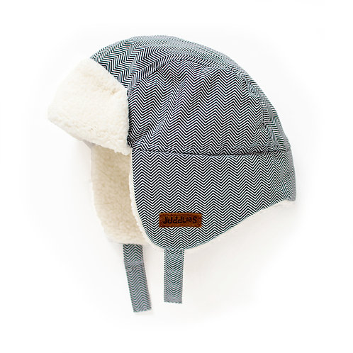 Side view of gray herringbone baby pilot hat with off-white fleece lining