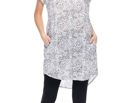 Model wearing short cap sleeve tunic with button front, sheer white leopard print