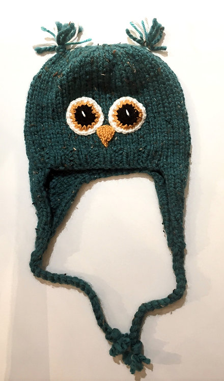 Green knit childs hat with earflaps & chin ties-owl eyes & beak stitched on-ear tassels at top of crown