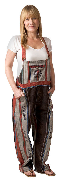 model wearing Ark Fair Trade Shankar Overalls, black white and red with sun motif on bib pocket