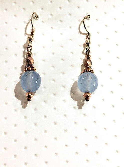 Pair of rose gold colored earrings with round gray 10mm stones