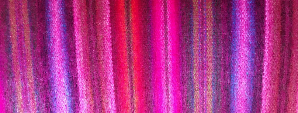 Close up of brilliant pink & purple striped blanket