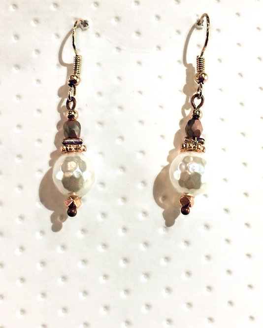 Pair of Rose gold colored earrings with round white 10 mm stones