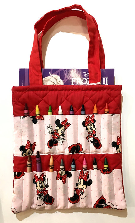 Flat rectangular red & pink cotton tote bag holding a crayon book & 16 slots for crayons on the front