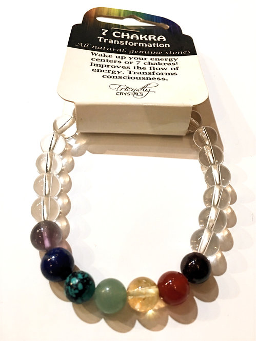 Close up of gemstone bracelet of clear crystal quartz beads and 7 colored stones representing the 7 chakras