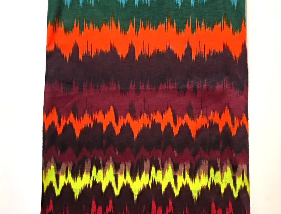 Rectangular tube of fabric with multi-colored seismic graph print