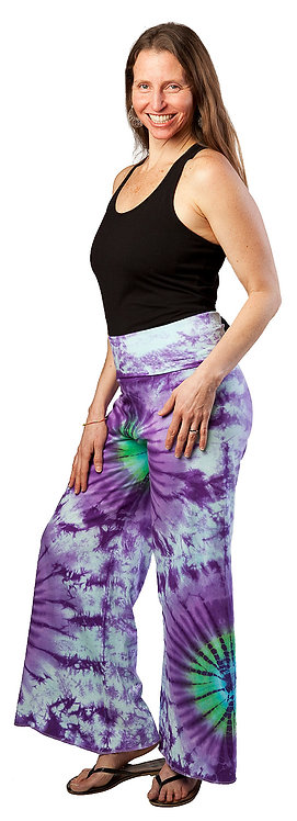 Model wearing purple & white tie-dye flared pants with bursts of green color