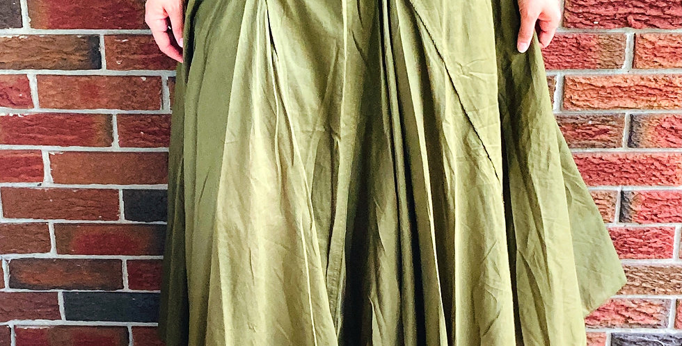 Model wearing full paneled skirt with fold-over waistband in olive green