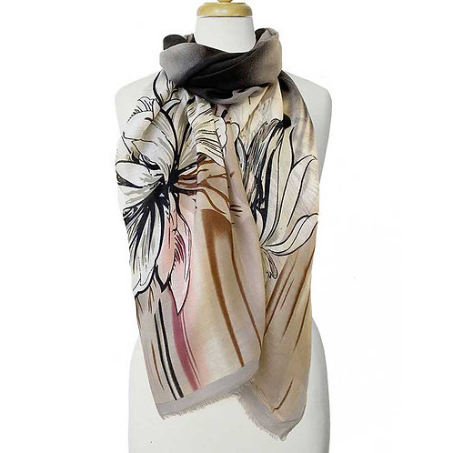 Large rectangular scarf in pastel shades with large gray flower wrapped around a mannequin