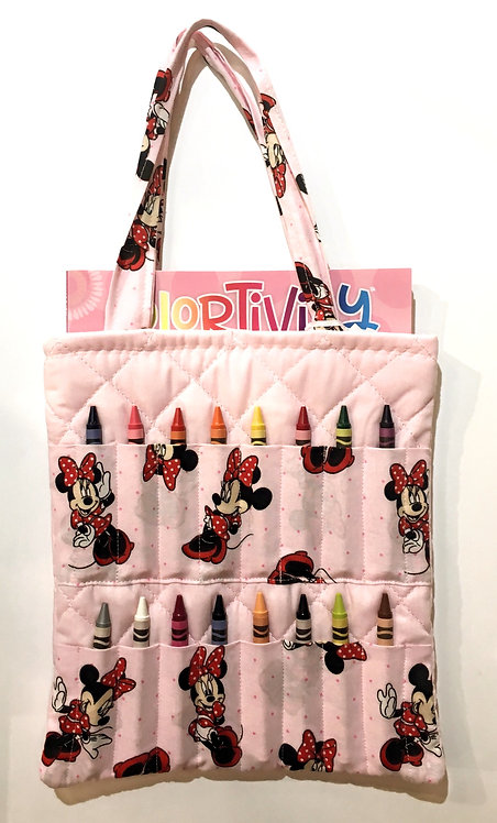 Flat rectangular pink cotton tote bag holding a crayon book & 16 slots for crayons on the front