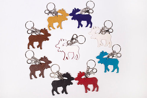 Moose shaped leather pieces attached to keychains and lobster claw clips arranged in a circle