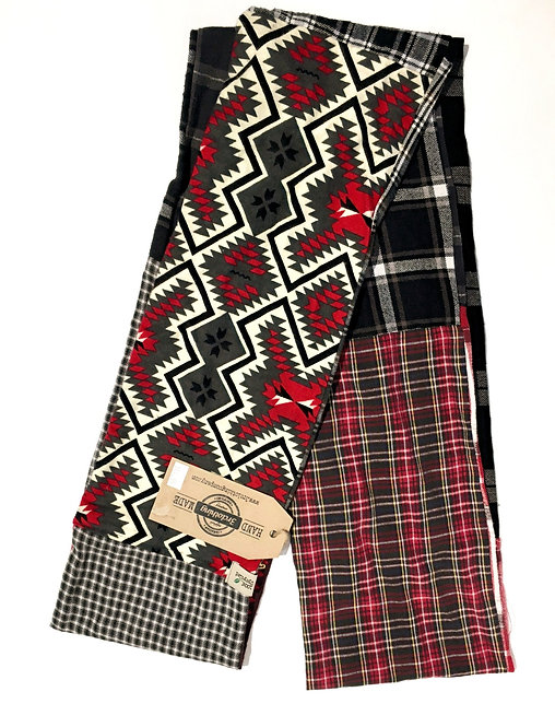 Side 1 of double sided patch flannel scarf, mostly green, blue, red, tan prints and plaids