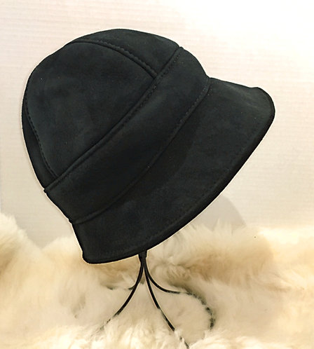 Right view of black Zelda paneled sheepskin hat with small peaked brim