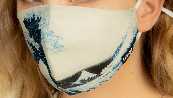 Angled left view close up model wearing snug fitting face mask-reproduction of Katsushika Hokusai's The Great Wave