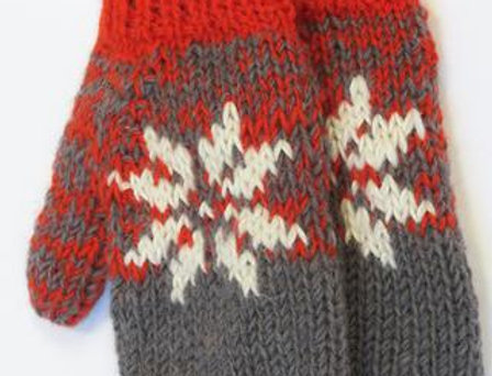 Orange & gray knit wool mitts with white snowflake pattern on back