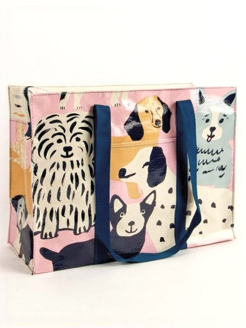 front view of roomy rectangular pink tote with black, brown & cream pictures of dogs