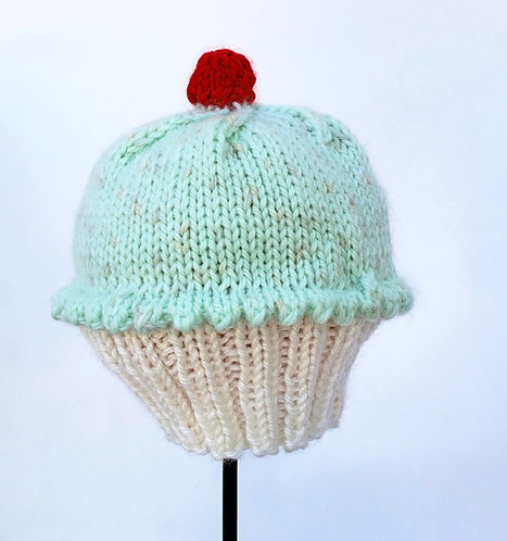 Hand Knit Infant Hat in the shape of a Cupcake with Mint Green icing and a red cherry on top