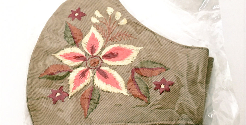 Side view of folded embroidered latte mask with 5-petal flower in yellow, peach & cranberry- leaves olive, bronze & cranberry