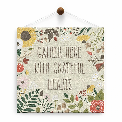 hanging beige square canvas card-fall colored flowers & foliage around outside-center text 'GATHER HER WITH GRATEFUL HEARTS'
