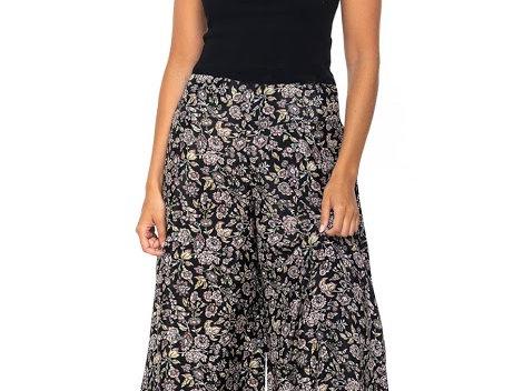 Model wearing black floral print wide leg pants