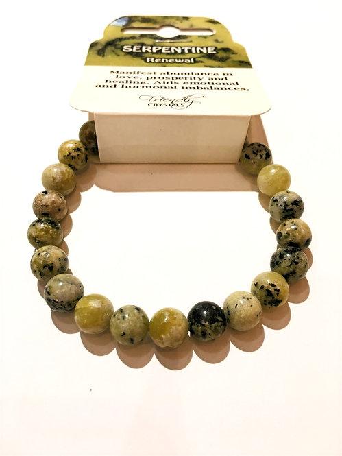 Close up of serpentine stone bead stretch bracelet