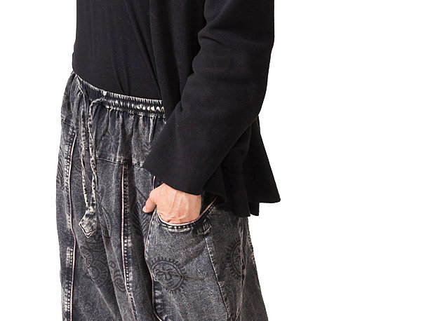 Model wearing stone-wash black drawstring elastic waist pants, 2 outer front pockets