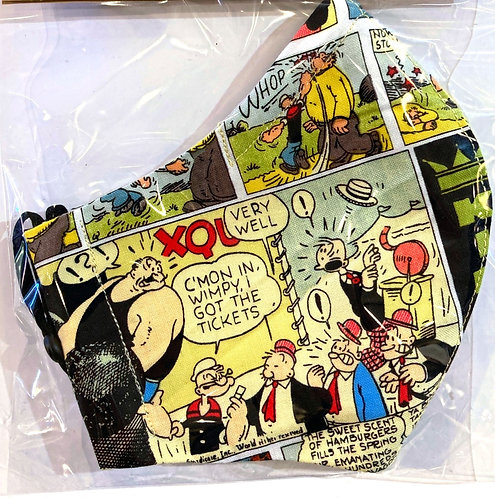 Close up of protective mask-yellow & black Wimpy comic-in plastic package