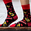 Model's feet wearing black socks printed with yellow bottles of maple, red & white strips of bacon & red maple leaves