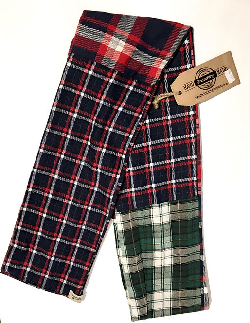 Side 1 of double sided patch flannel scarf, mostly red, blue, green & white plaids