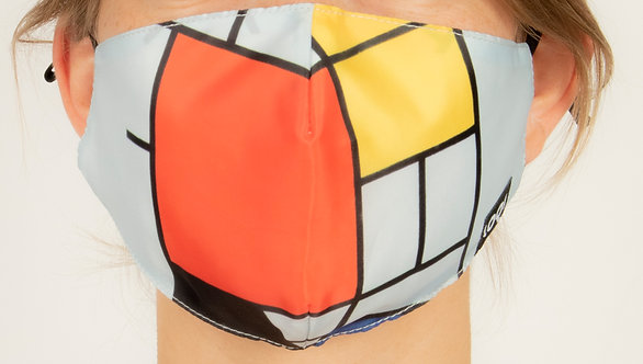 Front view close up model wearing fitted face mask with reproduction of Piet Mondrian's Composition with Red, Yellow, Blue