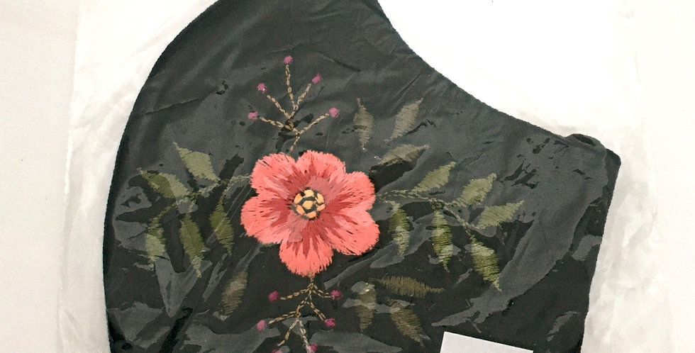 Side view of folded black cotton mask with embroidered coral flower & green leaves